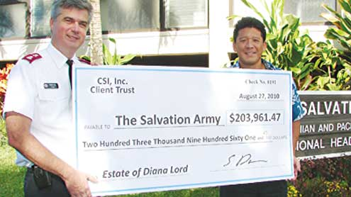 Salvation Army officer holds big check.