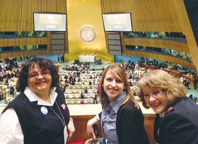 Major Jessyca Elgart, Stephanie Freeman, and Major Nila Fankhauser in the General  Assembly at the opening session of the Commission on the Status of Women