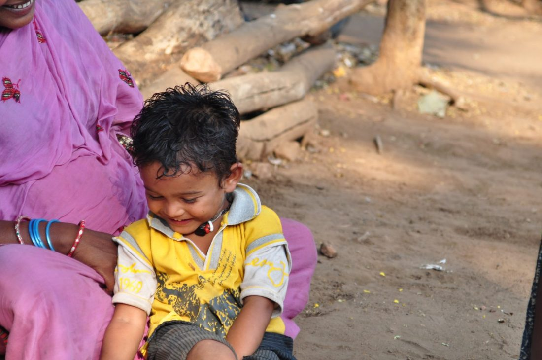 Child smiling mothers lap