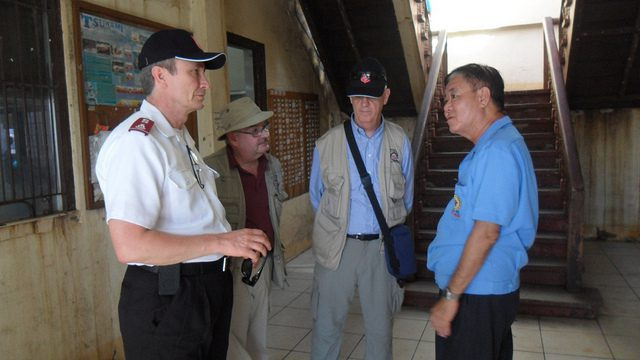 Col Bill Mockabee (SAWSO); Major Mike McKee (IES deployee), Major Ray Brown (IES) with the Mayor of Dulag during field visit - Dulag