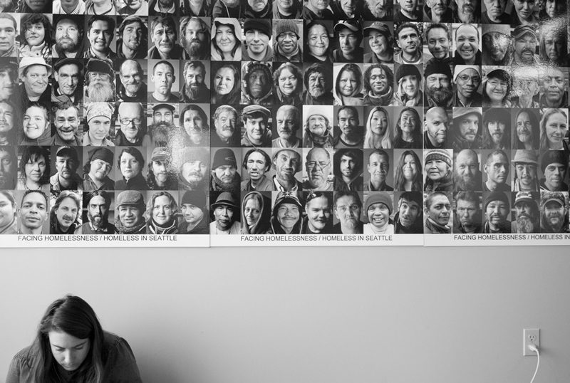 A volunteer works in front of a portrait of individuals facing homelessness | Photos courtesy of Hack To End Homelessness