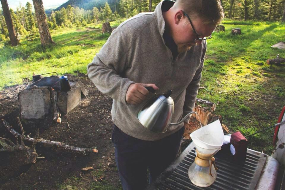 GoodWorks Coffee & Tea Founder Sam Cornthwaite making a cup of coffee overlooking the Bridger Mountain range in his home state, Montana.