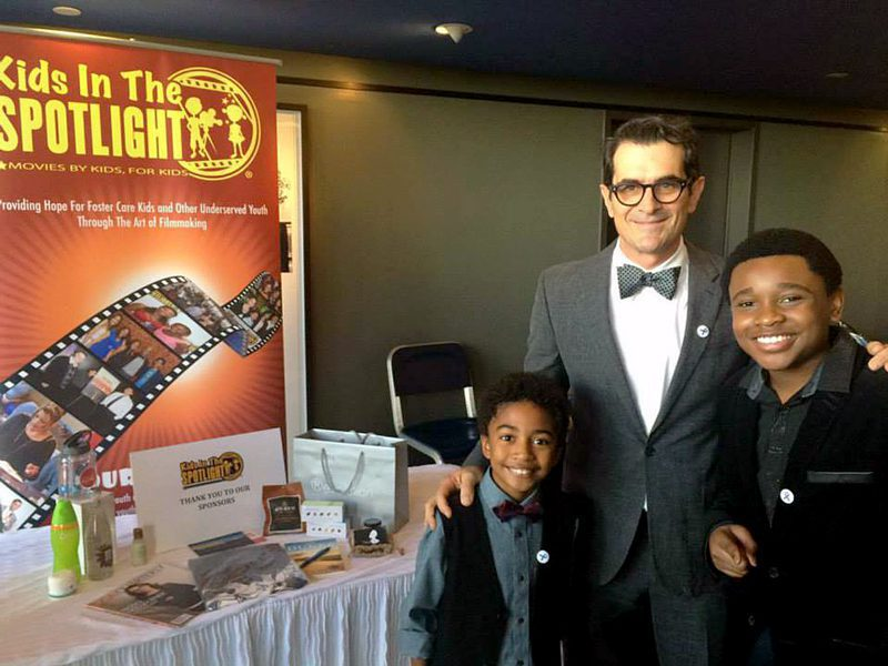 """Actor Ty Burrell of """"Modern Family"""" with Kids In The Spotlight participants."""