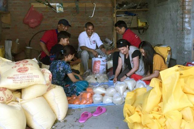 International Emergency Services Field Officer Damaris Frick assists in preparing food for distribution.