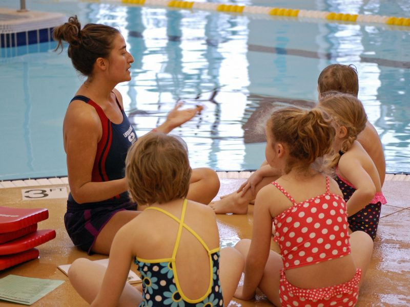 Woman with kids at swimming pool
