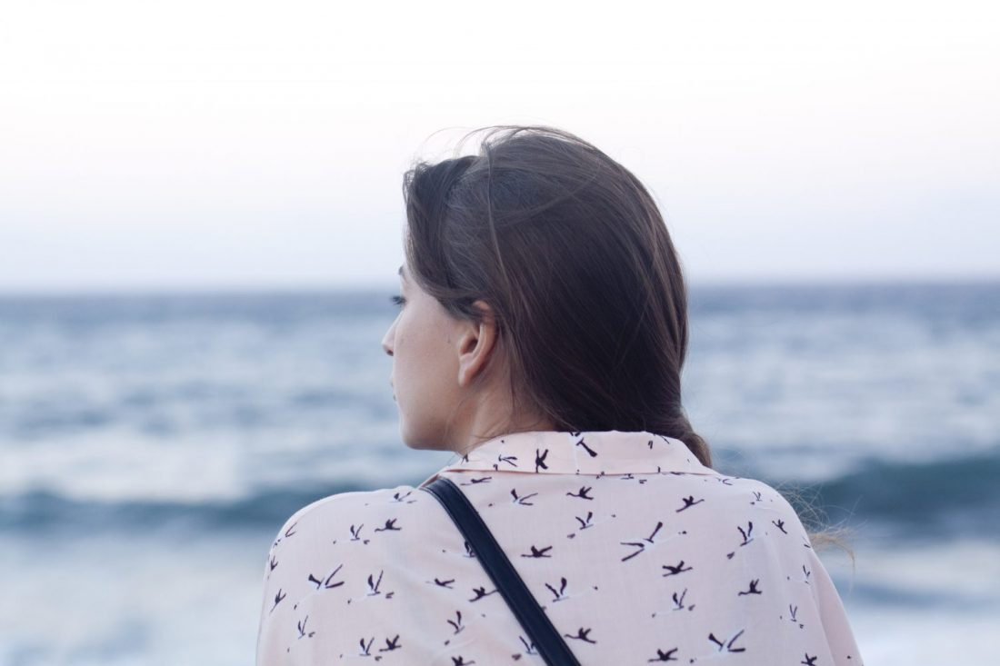 Woman looking out at ocean