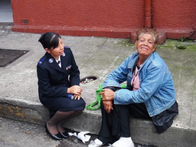 Officer with woman on street