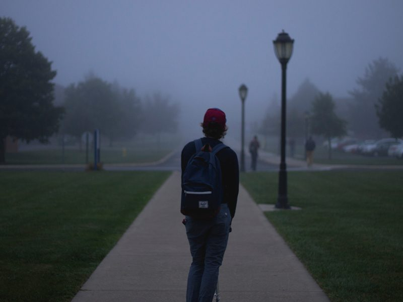 Person walking with backpack outside