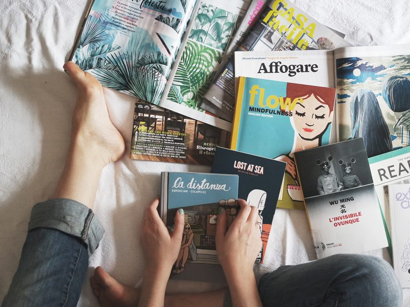 Multiple books on bed