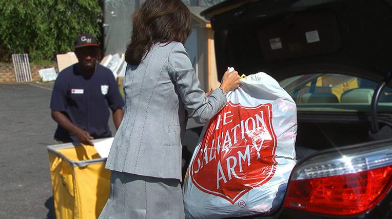 Woman holding Salvation Army plastic bag