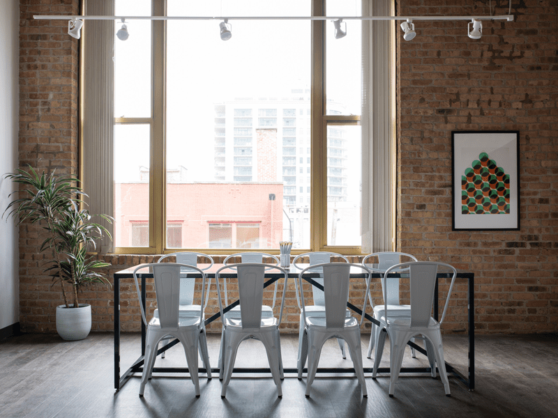 Table with chairs around it by window