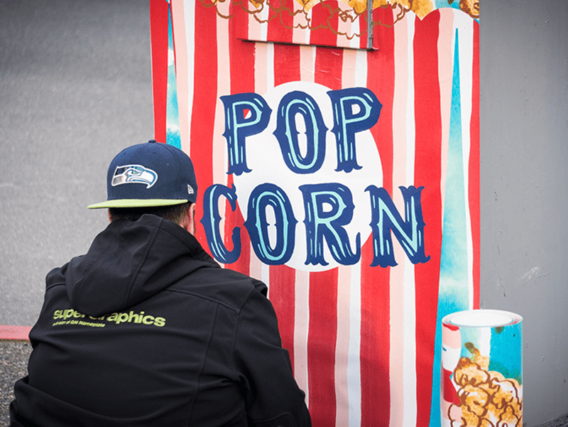 Large painting of popcorn bag outside