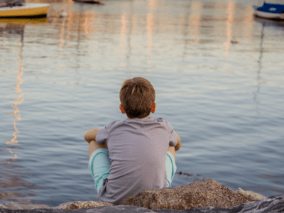 Child looking out at water