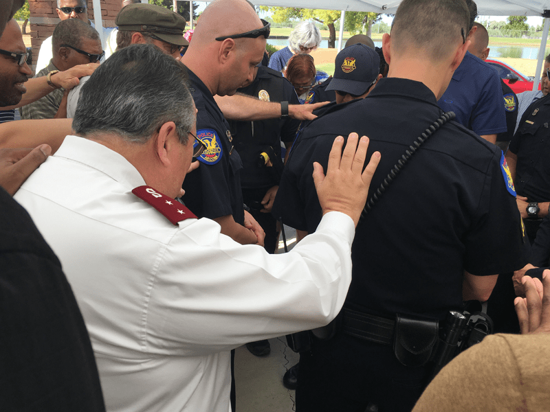 Salvation Army and Police Officers praying together