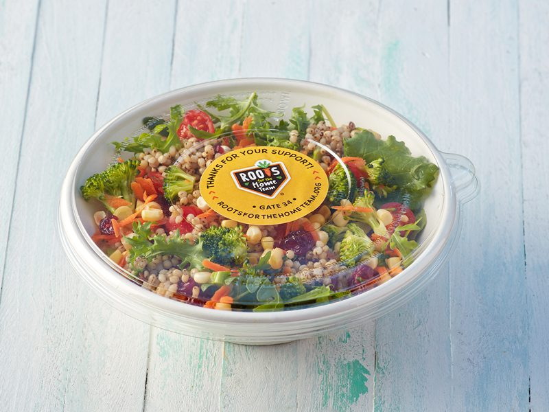 Salad in bowl with plastic cover