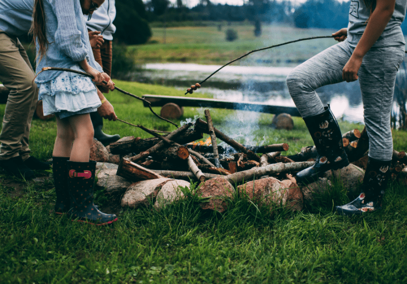 two people making campfire