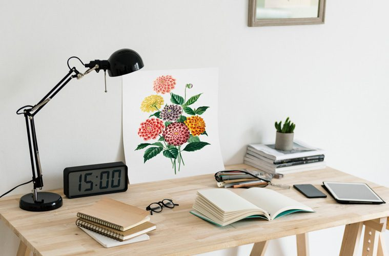 open book and painting on desk with lamp
