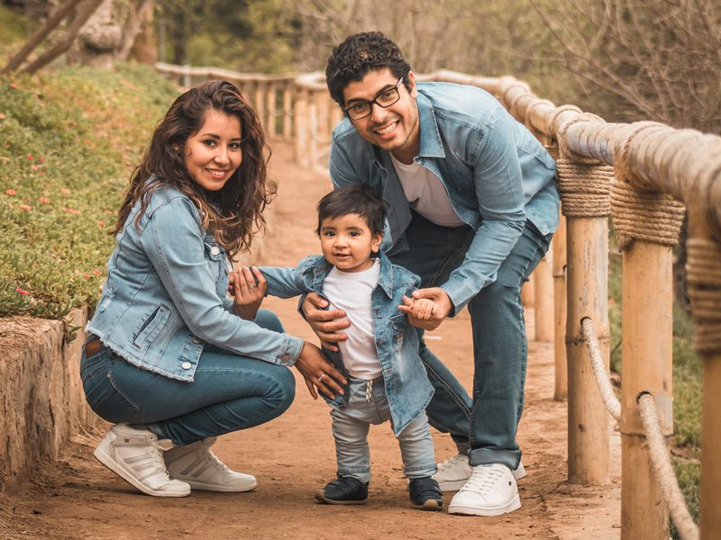 Husband and wife with child outsdie