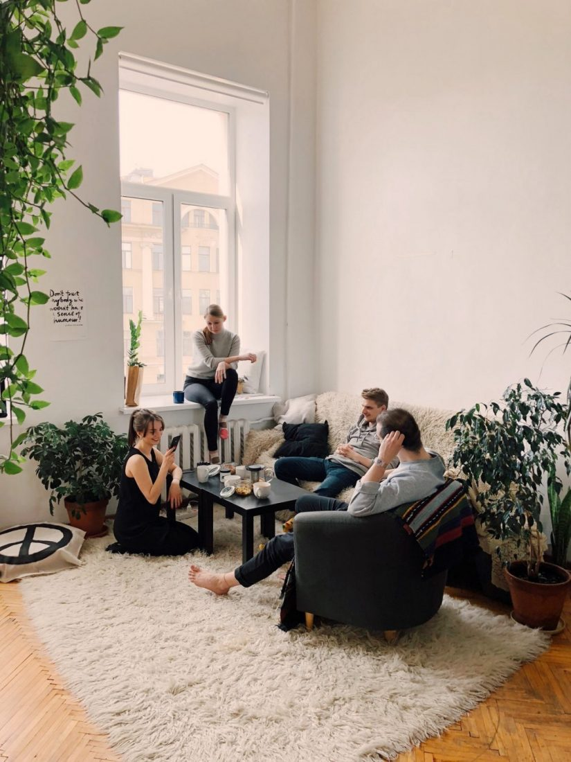 group of friends sitting in a room
