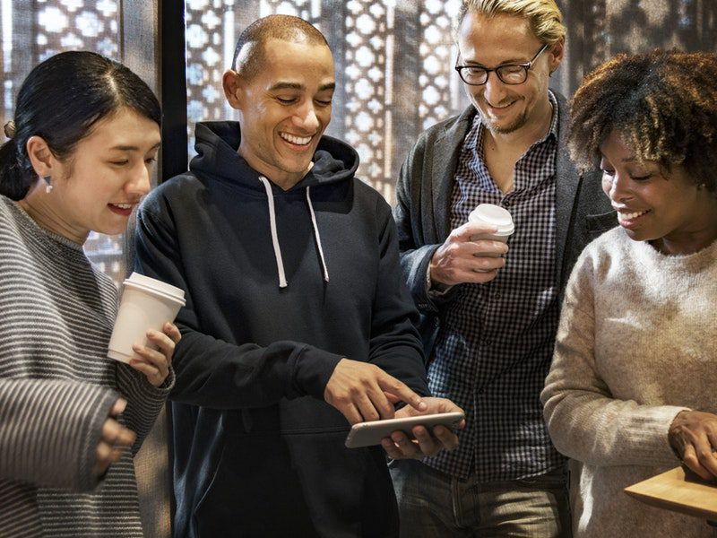 group of people watching something on persons phone