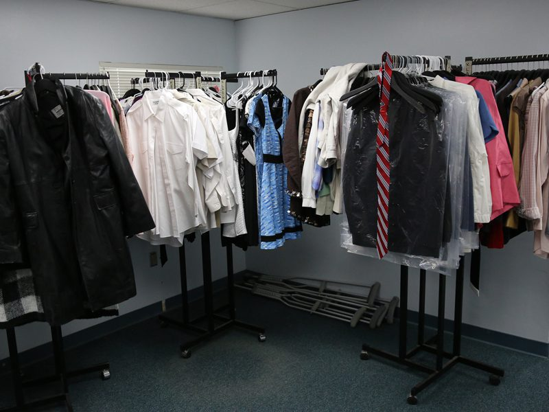 Male and Female clothes hung up at homeless shelter