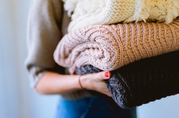 A stack of blankets being held