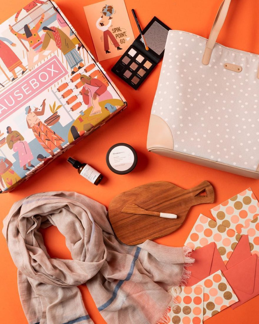 Cause Box Featuring Makeup, Small Cutting Board, Scarf, Cards, and Bag
