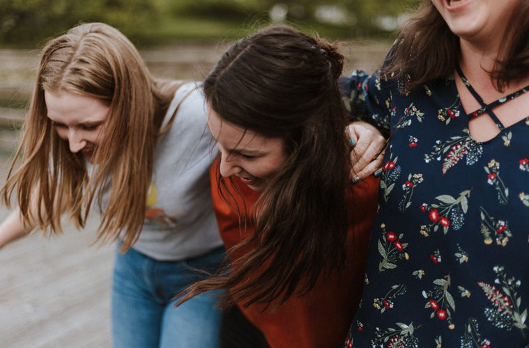 Female Friends Happy with Arms Around Each Other