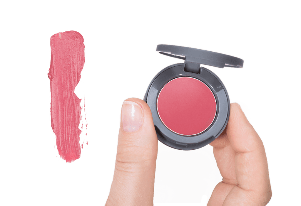 Red Stowaway Cosmetics Being Held Showing Product