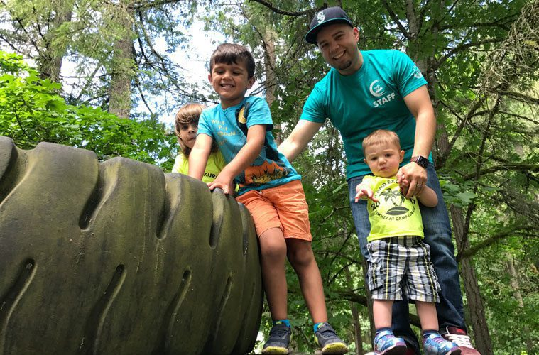 Counselor Joshua Hamilton Playing with Three Kids at Camp