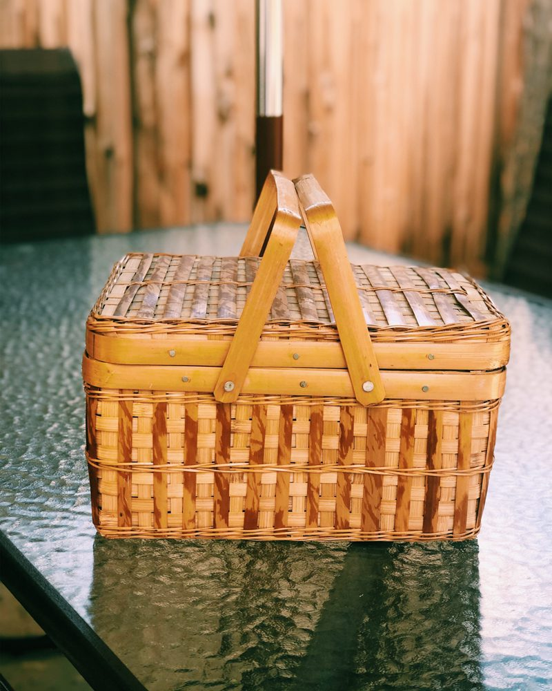 Closed Picnic Basket on Glass Table