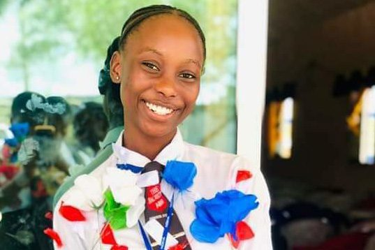 Junita H. Sangare smiles after being recognized and rewarded as one of the top 13 students in Liberia