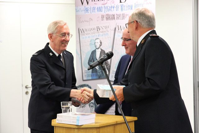 Gordon Taylor Shaking Hands During Presentation of his Book