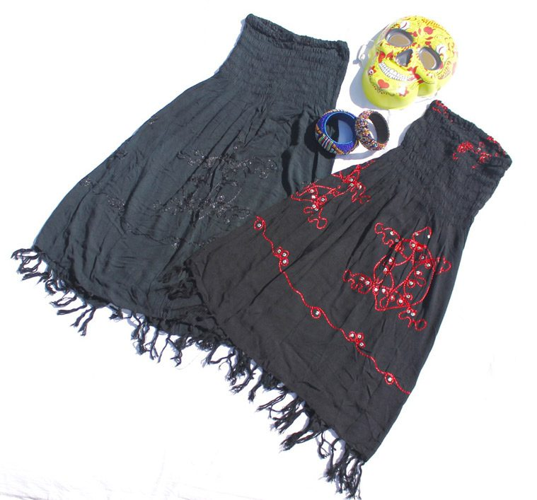 black dresses with yellow and red mask for dia de los metros costume