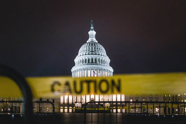 Caution tape in front of Capital