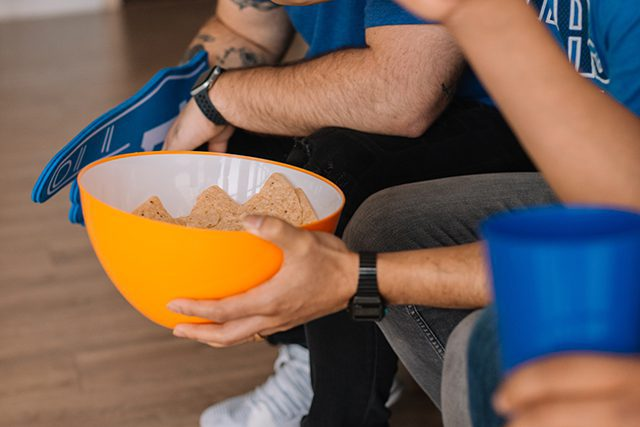Chip Bowl Being Held By Friends on Couch