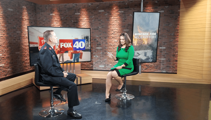 Salvation Army Officer speaking with Fox 40 Anchor