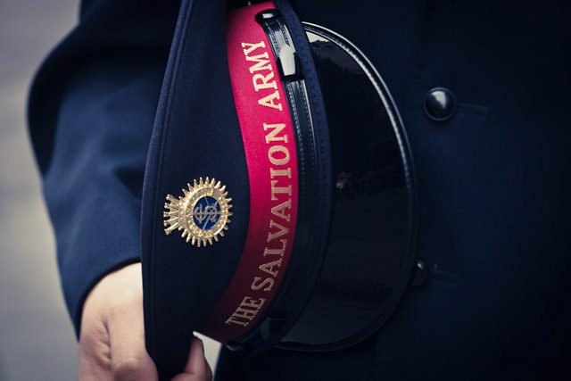 Close-up of Officer Holding Hat