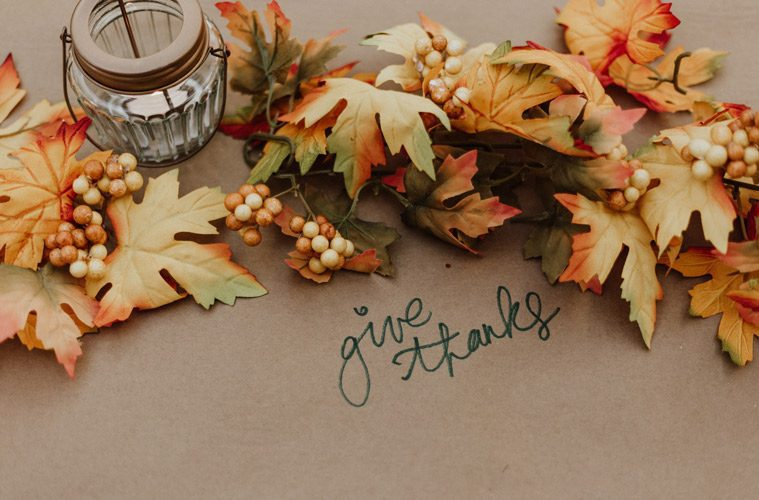 """Leaves surrounding the words """"give thanks"""""""