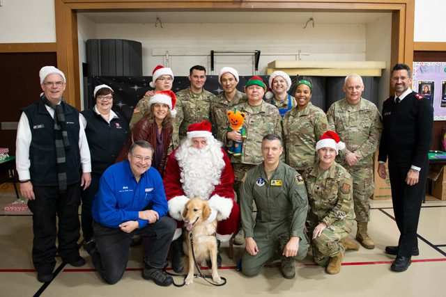 National Guard Members and Salvation Army Members Taking Group Photo