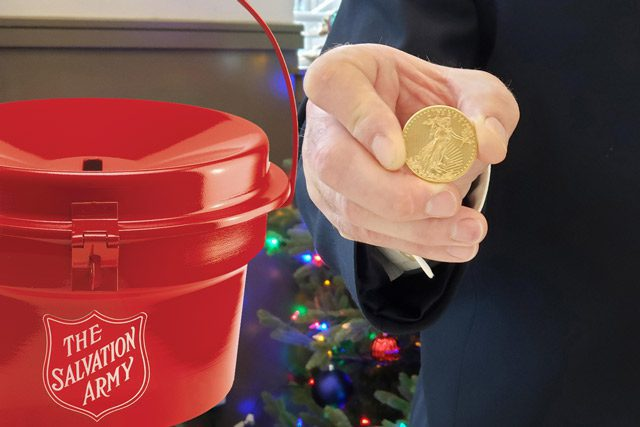 gold coin in front of red kettle