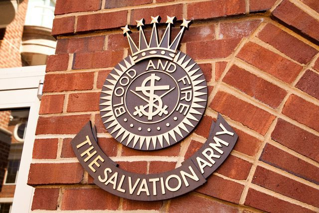 Salvation Army crest on brick wall