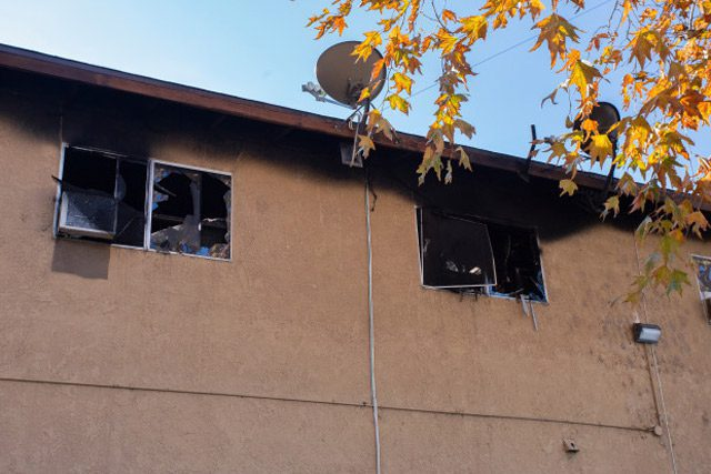 Damage from fire on outside of apartment