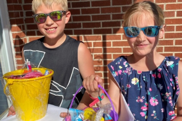 Young boy and girl with easter baskets