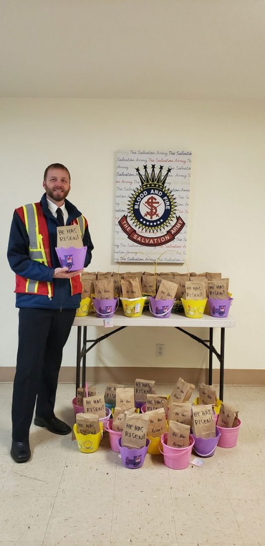 EDS worker in front of Easter bags on table