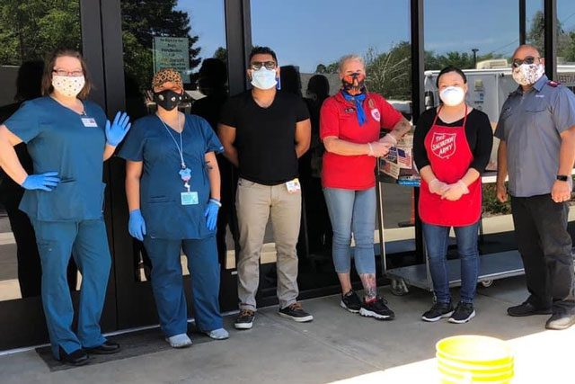 Group outside with masks