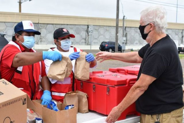EDS workers distributing supplies